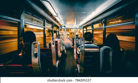 Motion blur of Interior of a tram car rushing through Hong Kong island streets at night