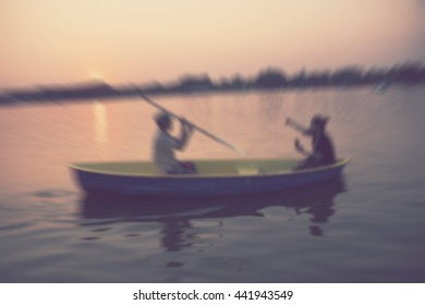 motion blur lovers on boat - abstract blurred background