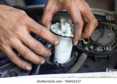 motion blur of mechanic repairing a motorcycle