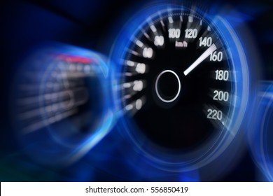 Motion blur of modern car instrument panel dashboard with blue illuminated display, rev up.