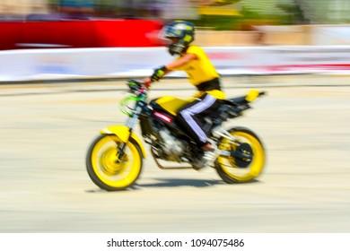 Motion blur of motocross Bike, panning technique.