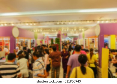Motion blur of people in sweet dessert festival , many shop in food fair in departmentstore , crowd shopping food and dessert at the shop