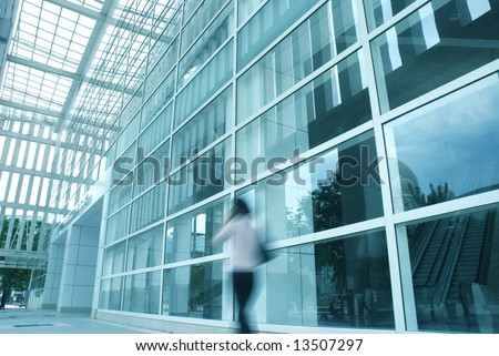 motion blur of people with various activities and buildings in blue tone
