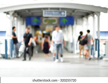 motion blur of people walk in front of shopping mall