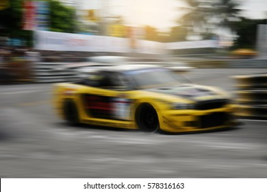 Motion blur of race car racing on speed track.