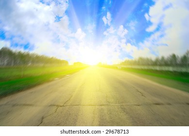 motion blur road and sunrise on blue sky