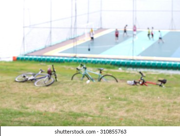 motion blur of three bicycle with players playing football