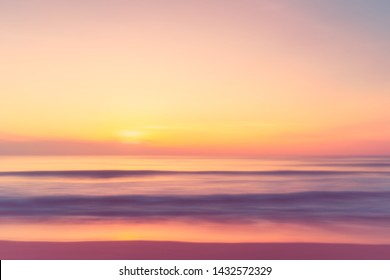 Motion blur tropical sunset beach with bokeh light wave abstract background. Copy space of summer vacation and business travel adventure concept. Vintage tone filter effect color style.