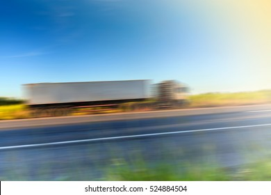 Motion Blur of Truck on Highway at morning light