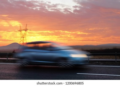 Motion blur van on the road with sunrise color background