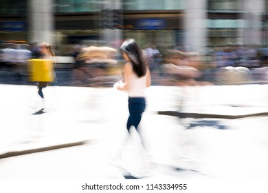 Motion blur of walking people crossing the road in the City of London, UK. Busy business life concept
