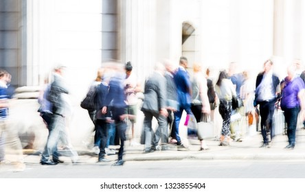 Motion blur of walking people. Modern competitive life concept. People walking next to the Bank of England wall. London, UK