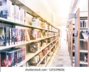 Motion blurred aisle and row of bookshelf at public library in Texas, America. Continuing education concept.