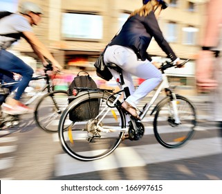 Motion blurred bicyclists on their home from work