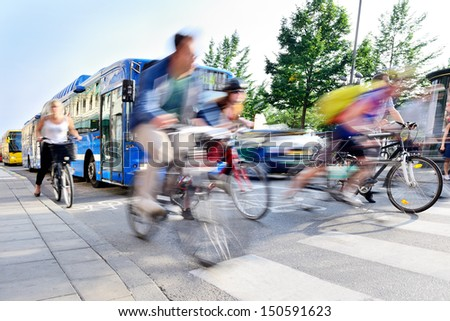 Motion blurred bicyclists in traffic