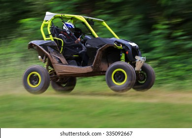 Motion blurred of buggy car in the off-road competition