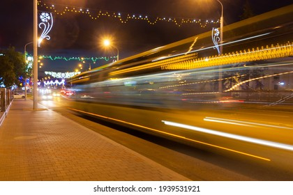 Motion blurred bus overpass in the evening. Photographed with a long exposure.
