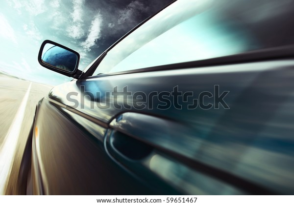 Motion blurred car on road
