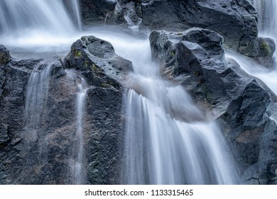 Motion blurred clean water spring with flowing water