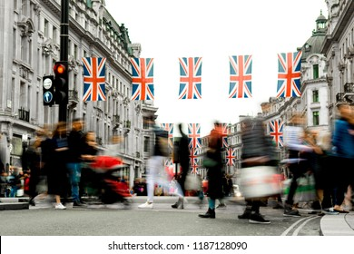 Motion blurred crowds of people on busy London shopping street