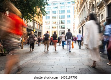 Motion blurred crowds of shoppers on busy London street