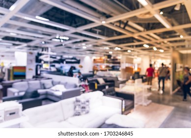 Motion blurred customer shopping for colorful sofas and couches in different materials at furniture retail store in Texas, America. Variety of furniture in shapes, sizes, styles modular or bed sofa