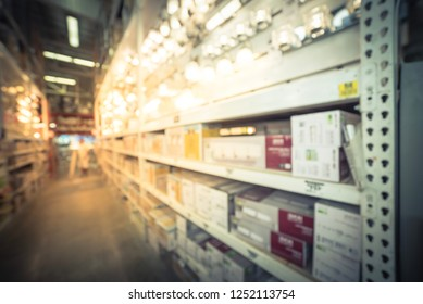 Motion blurred customer shopping for wall lights, vanity lighting, sconces on display at hardware store in America. Defocused indoor lighting decoration