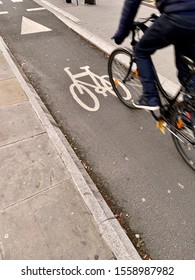 Motion blurred cyclist uses a cycle lane in London