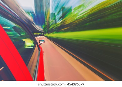 Motion blurred drive through the city via taxi cab