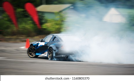 Motion blurred of driving a drift car by a skilled driver and having experience on a speed track