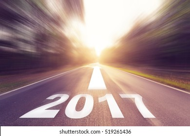 Motion blurred empty asphalt road and New year 2017 concept.