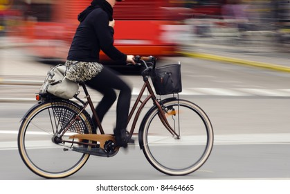 Motion blurred female biker