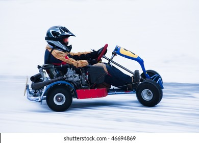 Motion blurred image of go kart race in winter