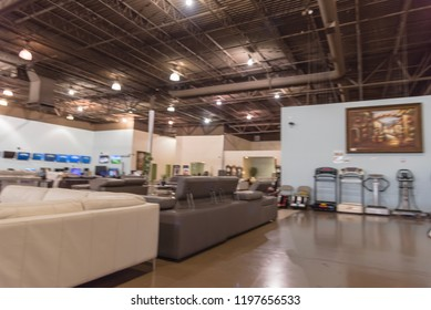 Motion blurred living room sets, sofa and home appliances at Asian furniture showroom store