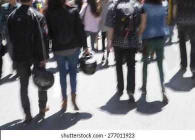 Motion blurred pedestrians on city street