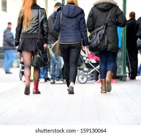 Motion blurred pedestrians on sidewalk