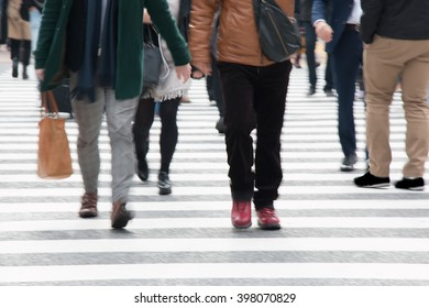 Motion blurred  people across Pedestrians at Shibuya Junction, Tokyo, Japan