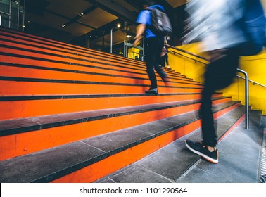 Motion blurred people going up the stairs in downtown Melbourne, Australia