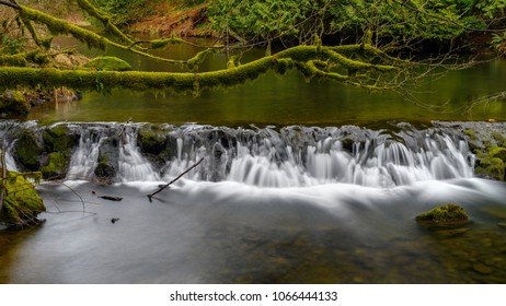 Motion blurred photo of the running Weaver Creek in Fraser Valley, British Columbia, Canada