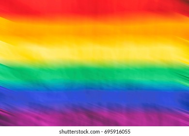 Motion blurred picture of a gay rainbow flag during pride parade. Concept of LGBT rights.