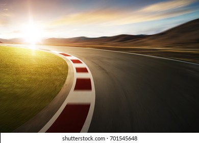 Motion blurred racetrack with mountain background , Sunset scene .