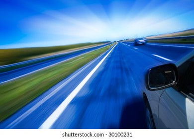 motion blurred road and car