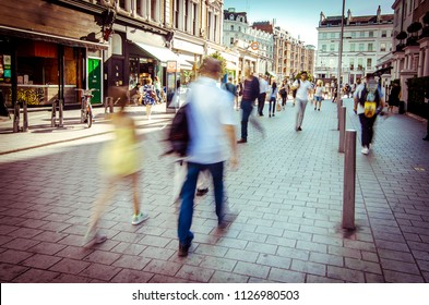 Motion blurred shoppers on London high street