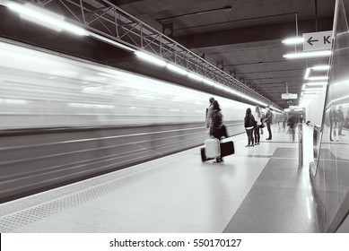 Motion blurred subway train. black and white.