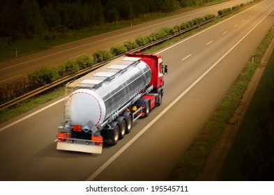 Motion blurred tanker truck on the highway. Industry and pollution concept.