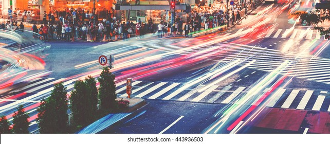 Motion blurred traffic at Shibuya Crossing, one of the busiest crosswalks in the world. Tokyo, Japan