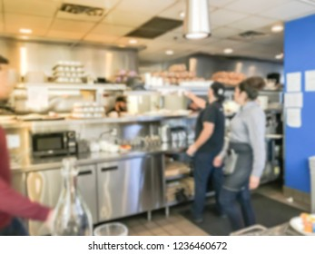 Motion blurred waitress serving ordered dishes from kitchen of breakfast restaurant in Chicago, USA