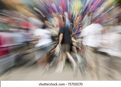 Motion blurred zoom of crowd of people walking
