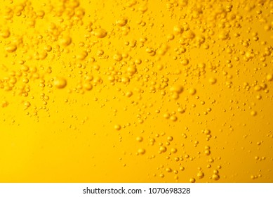 Motion of bubble oil liquid gasoline or beer  juice syrup yellow color for background