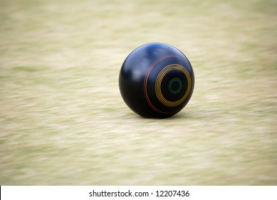 Motion Captured of rolling ball during a Lawn Bowl Game.